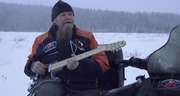 Playing guitar on the sled